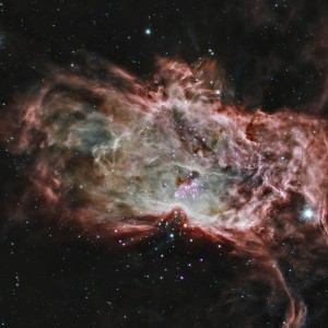 A star cluster in the center of the Flame Nebula about 1,400 light years from Earth.